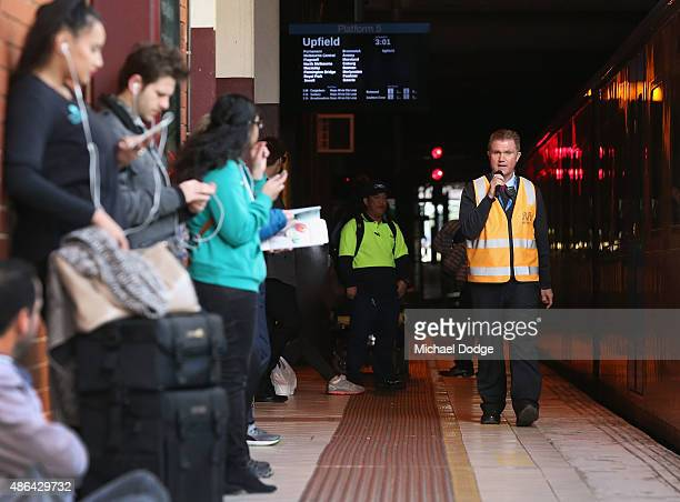 A train worker announces at Flinders Street Station that trains are running again after a strike by Rail Tram and Bus Union workers on September 4...