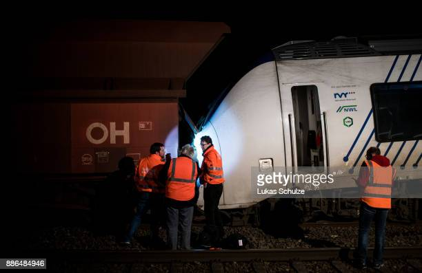 Train workers inspect the wreckage of two trains that collided in MeerbueschOsterath district are seen on December 5 2017 in Dusseldorf Germany...