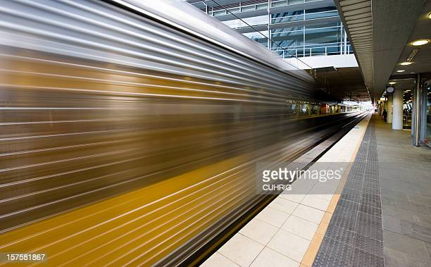 Train zooming through station