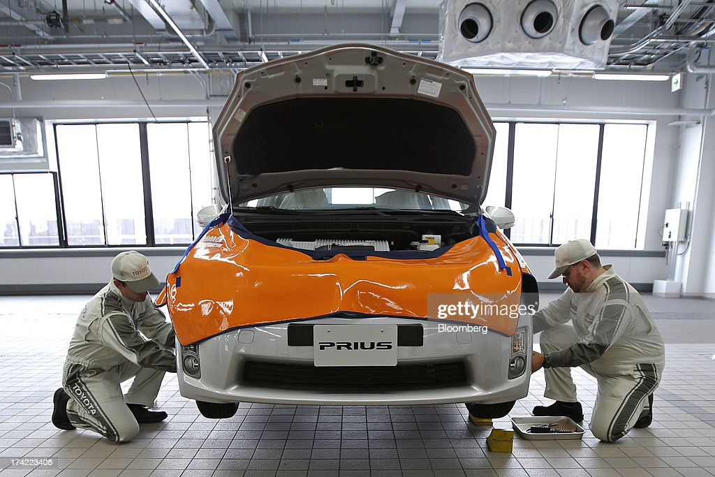 Trainee after-service staff work on a Toyota Motor Corp. Prius hybrid vehicle during a maintenance training demonstration at the company's Tajimi service center in Tajimi, Gifu Prefecture, Japan, on Monday, July 22, 2013. Toyota is the world's largest car maker. Photographer: Kiyoshi Ota/Bloomberg via Getty Images