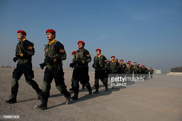 Trainee bodyguards of the Genghis Security Academy arrive in formation at an army training ground on the outskirts of Beijing on January 18 2013 In...
