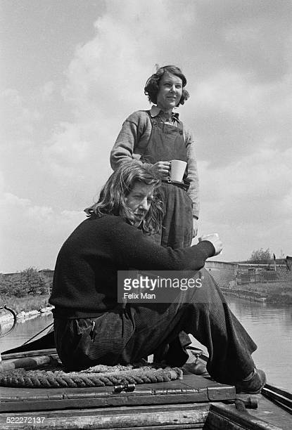 Trainee crew members Susan Blood and Mary Andrew take a tea break on a barge on a canal in the English Midlands during a training trip from London...