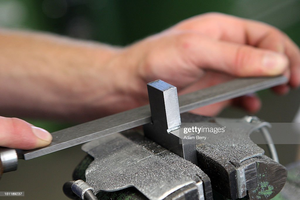 A trainee files a piece of metal at a Siemens training center on September 3, 2012 in Berlin, Germany. Nearly 400 trainees began their apprenticeship training programs today at an in-house educational facility at the Siemens factory in Berlin.