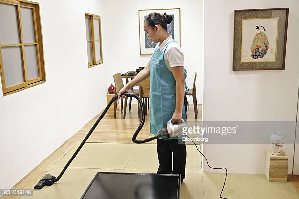 Trainee housekeeper Maria Del Bago vacuums tatami floormatting in a Japanese style apartment during a training session at the Magsaysay Center for...