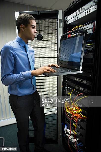 IT trainee in server room