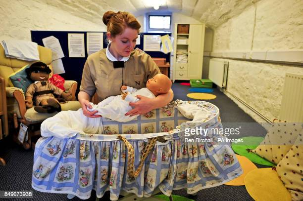 Trainee 'Norland Nanny' Simone Fulford practices making up a Moses basket in the practical skills area at Norland College York Place London Road Bath...