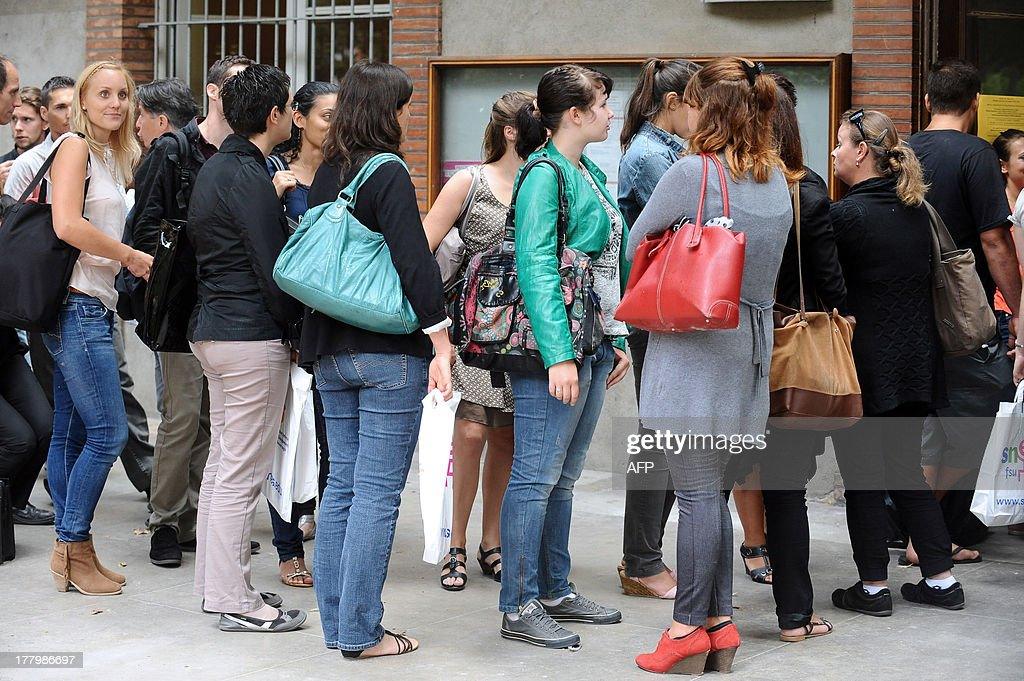 Trainee teachers wait at the Faculty of Social Sciences to register in the first high school for teaching and education (Ecoles Superieures du Professorat et de l'Education -Espé) on August 26, 2013 in Toulouse, southern France.