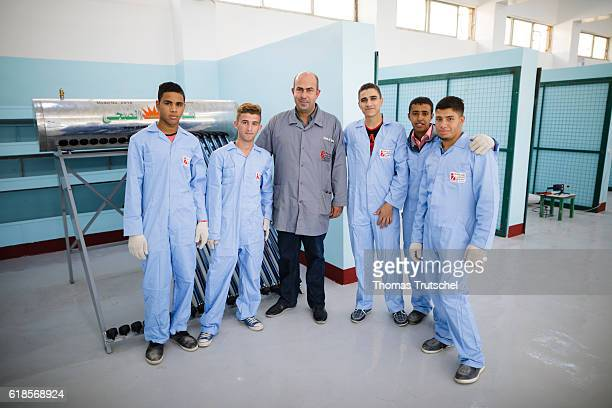 Trainees are posing at the vocational training center VTC with their instructor for a photo on October 05 2016 in Al Rusaifeh Jordan