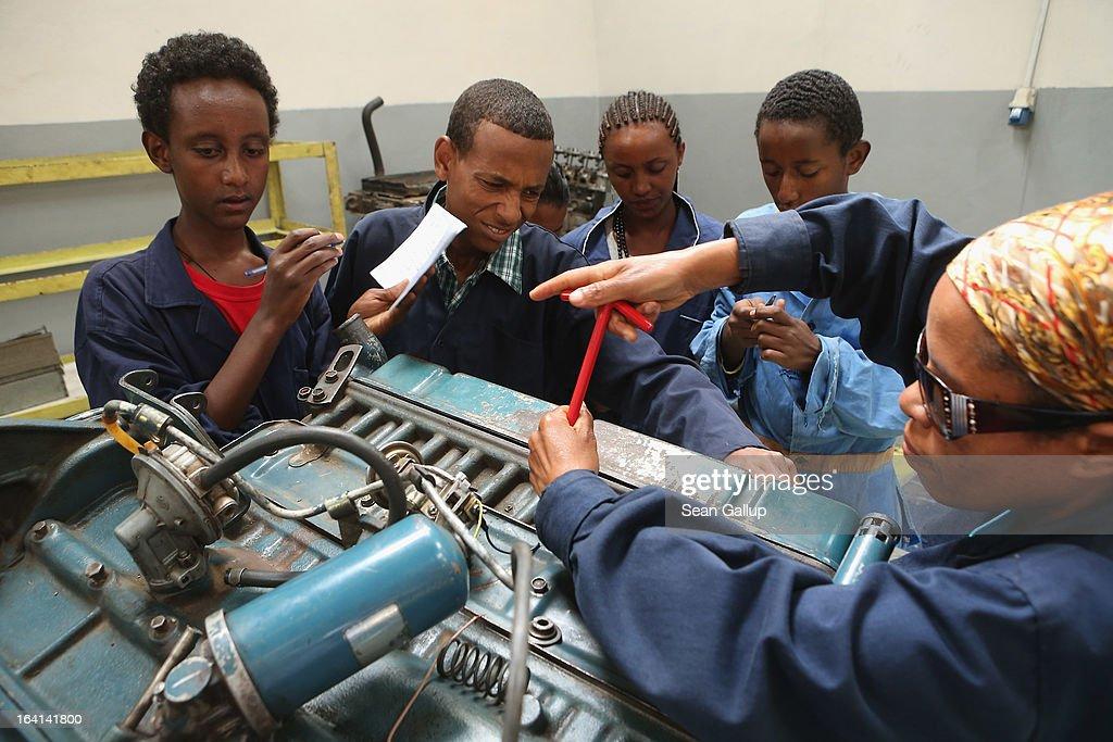 Trainees remove the spark plugs from a truck's engine to check their specifications in the automotive technology class at the AA Tegbare-id Polytechnic College on March 20, 2013 in Addis Ababa, Ethiopia. The AA Tegbare-id Polytechnic College is supported by Germany's KFW Development Bank and the GEZ as well as the Italian government. Ethiopia, with an estimated 91 million inhabitants, is the second most populated country in Africa and the per capita income is $1,200.