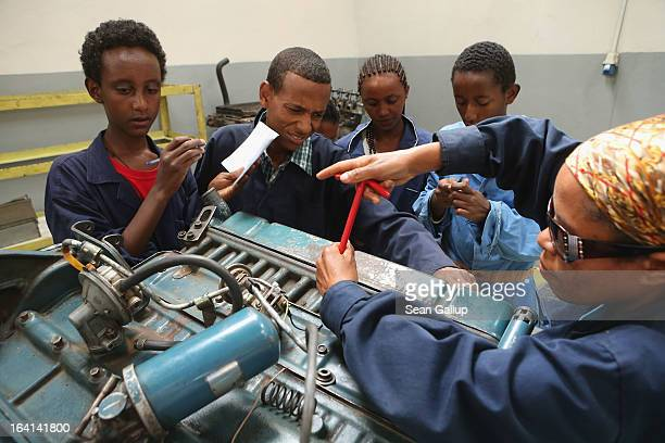 Trainees remove the spark plugs from a truck's engine to check their specifications in the automotive technology class at the AA Tegbareid...
