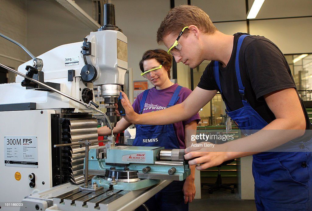 Trainees use a milling machine at a Siemens training center on September 3, 2012 in Berlin, Germany. Nearly 400 trainees began their apprenticeship training programs today at an in-house educational facility at the Siemens factory in Berlin.