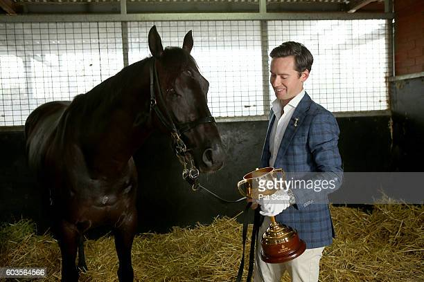 Trainer Adrian Bott with The Melbourne Cup and his horse Melbourne Cup entrant Excess Knowledge at The Melbourne Cup Weights Announcement at...
