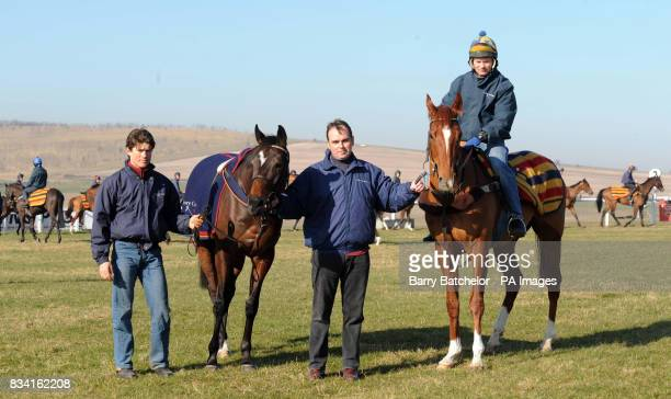 Trainer Alan King holds two of his Cheltenham Festival hopes they are Katchit help by Christophe Dallaporta and Franchoek with Michael O'Brien on top...