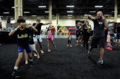 FIT trainer and dietician Mike Dolce instructs participants in training moves during the UFC Fan Expo 2014 during UFC International Fight Week at the...