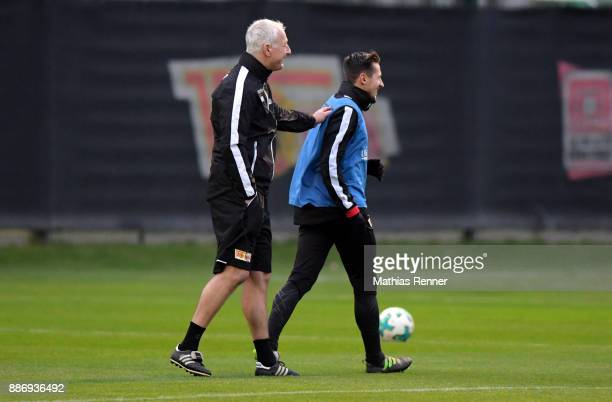 Trainer Andre Hofschneider and Steven Skrzybski of 1 FC Union Berlin during the 1 FC Union Berlin training on December 6 2017 in Berlin Germany