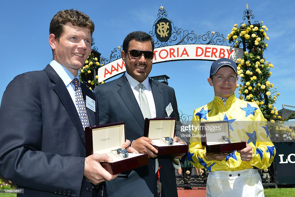 Trainer Andrew Balding, Sheikh Fahad and Jamie Spencer after Side Glance won Race 5 Longines Mackinnon Stakes during Derby Day at Flemington Racecourse on November 2, 2013 in Melbourne, Australia.