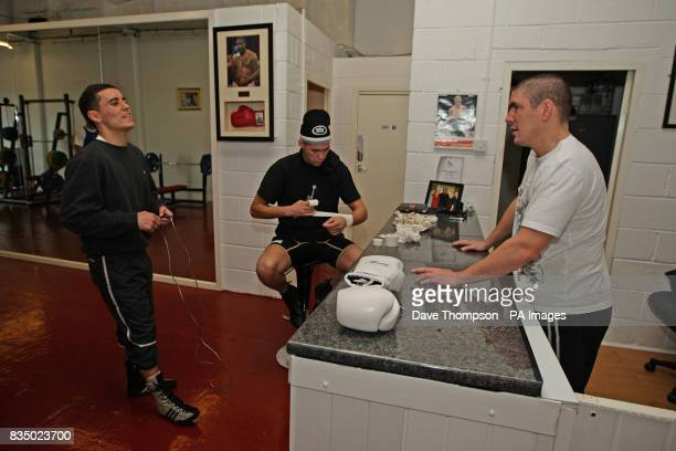 Trainer Anthony Farnell in conversation with boxers Tony Bellew and Frankie Gavin during a training session at the former WBU Middleweight Champion...