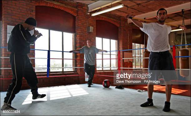Trainer Anthony Farnell watches boxers Tony Bellew and Joe Selkirk during a training session at the former WBU Middleweight Champion Farnell's Arnies...