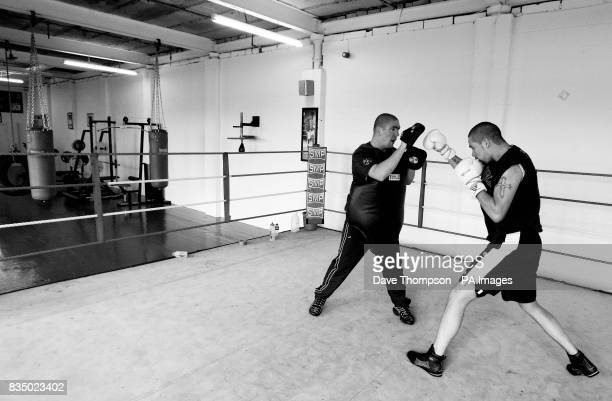 Trainer Anthony Farnell with boxer Tony Bellew during a training session at former WBU Middleweight Champion Farnell's Arnies Gym in Manchester