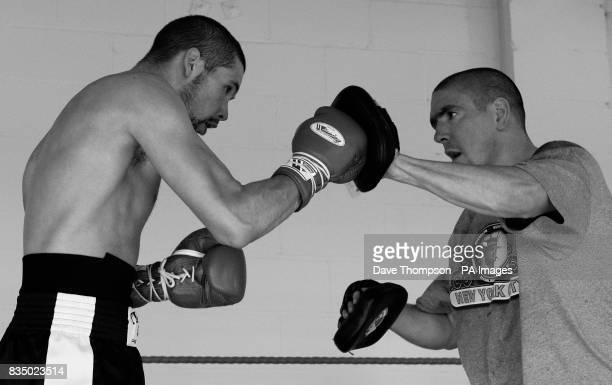 Trainer Anthony Farnell with boxer Tony Bellew during a training session at the former WBU Middleweight Champion Anthony Farnell's Arnies Gym in...