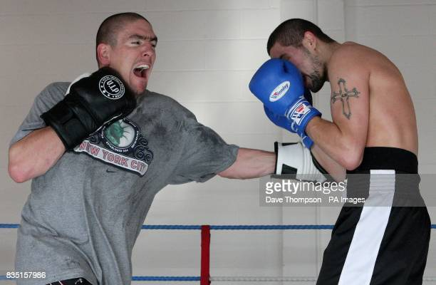 Trainer Anthony Farnell with Boxer Tony Bellew during a training session at Arnies Gym Manchester
