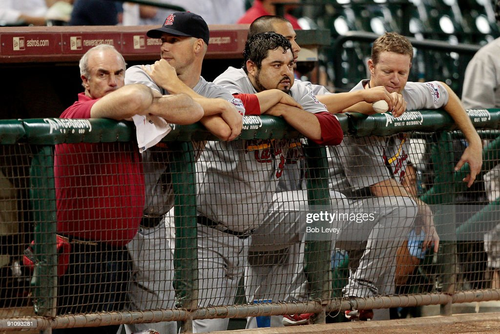 Trainer Barry Weinberg of the St. Louis Cardinals along with pitchers <a gi-track='captionPersonalityLinkClicked' href=/galleries/search?phrase=Chris+Carpenter+-+Baseball+Player&family=editorial&specificpeople=208139 ng-click='$event.stopPropagation()'>Chris Carpenter</a> #29 and <a gi-track='captionPersonalityLinkClicked' href=/galleries/search?phrase=Dennys+Reyes&family=editorial&specificpeople=216363 ng-click='$event.stopPropagation()'>Dennys Reyes</a> # #36 looks on from the bench in the ninth inning at Minute Maid Park on September 23, 2009 in Houston, Texas. Houston won 3-0.