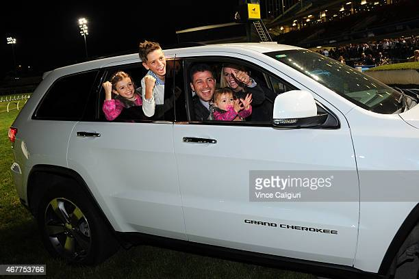 Trainer Brent Stanley and family poses with his new car after being awarded the Jeep 55 Second Challenge winning trainer during Melbourne racing at...
