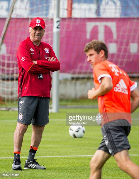 Trainer Carlo Ancelotti and Thomas Mller of FC Bayern Munich are seen during an training session on August 17 2016 in Munich Germany