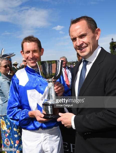 Trainer Chris Waller and Hugh Bowman pose with trophy after Winx won Race 5 Turnbull Stakes during Turnbull Stakes day at Flemington Racecourse on...