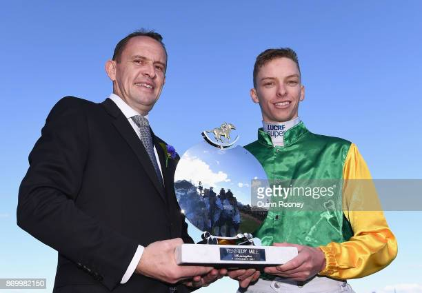 Trainer Chris Waller and jockey Michael Dee who rode Shillelagh pose with the trophy after winning race 8 the Kennedy Mile on Derby Day at Flemington...