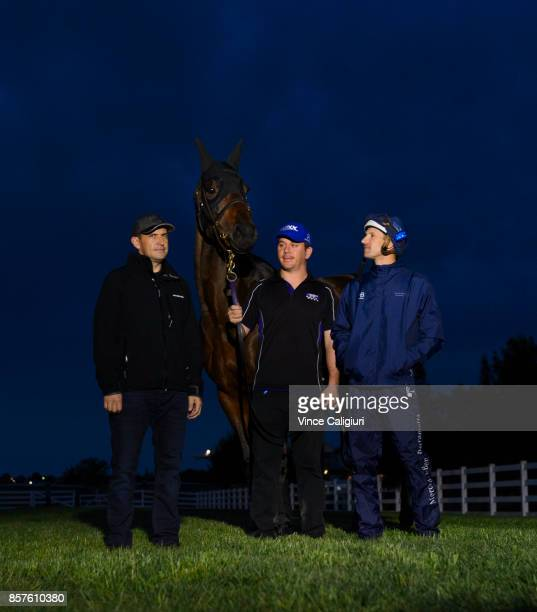 Trainer Chris Waller Jockey Hugh Bowman and strapper Umut Odemislioglu pose with Winx after a Trackwork Session at Flemington Racecourse on October 5...