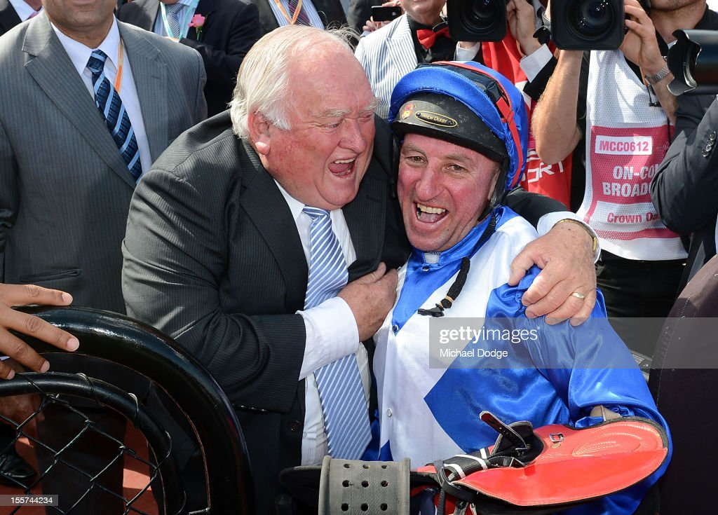 Trainer Clarry Conners hugs jockey Jim Cassidy winning the Crown Oaks during the 2012 Crown Oaks Day at Flemington Racecourse on November 8, 2012 in Melbourne, Australia.