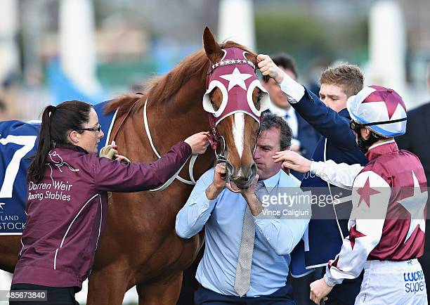 Trainer Darren Weir adjusting Stratum Star gear before Race 8 the Memsie Stakes during Melbourne racing at Caulfield racecource on August 29 2015 in...