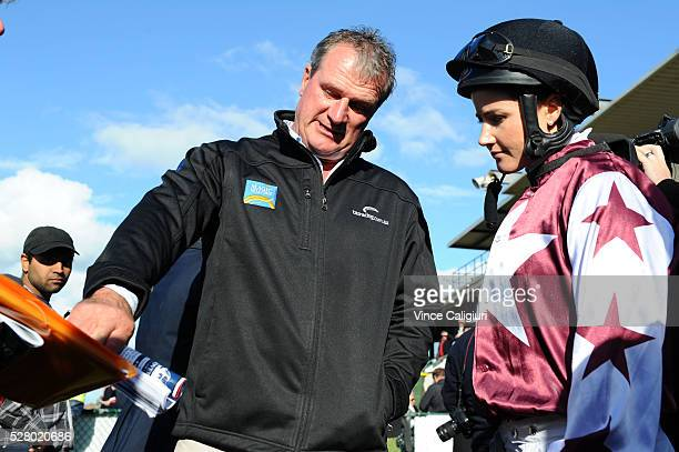 Trainer Darren Weir giving Michelle Payne instructions before Race 8 the Wangoom Handicap during Brierly Day at Warrnambool Race Club on May 4 2016...
