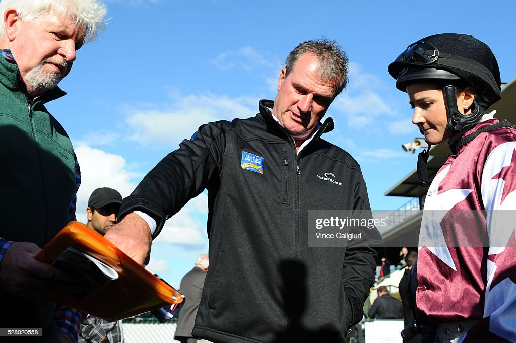 Trainer Darren Weir giving <a gi-track='captionPersonalityLinkClicked' href=/galleries/search?phrase=Michelle+Payne&family=editorial&specificpeople=2296250 ng-click='$event.stopPropagation()'>Michelle Payne</a> instructions from Racing manager Peter Ellis before Race 8, the Wangoom Handicap during Brierly Day at Warrnambool Race Club on May 4, 2016 in Warrnambool, Australia.
