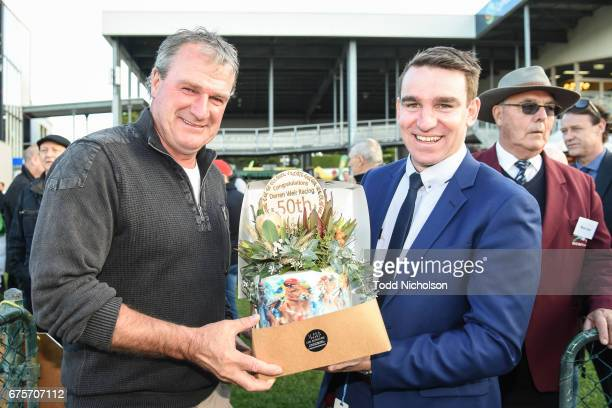 Trainer Darren Weir is presented with a moment by Peter Downs after winning the City of Warrnambool Handicap his 50th win at the May Carnival at...
