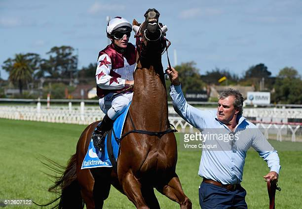 Trainer Darren Weir leads Trust in a Gust onto the track with Brad Rawiller on board before Race 6 Futurity Stakes during Melbourne Racing at...