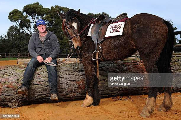 Trainer Darren Weir poses with his pony Bart after a Ballarat trackwork session at Ballarat Turf Club on July 23 2014 in Ballarat Australia
