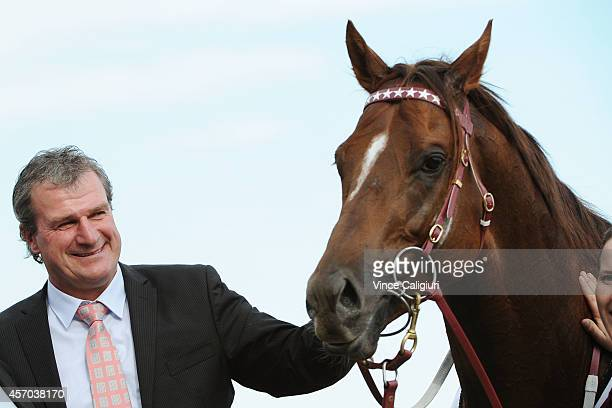 Trainer Darren Weir poses with Trust in a Gust after winning Race 7 the David Jones NBCF Toorak Handicap during Caulfield Guineas Day at Caulfield...