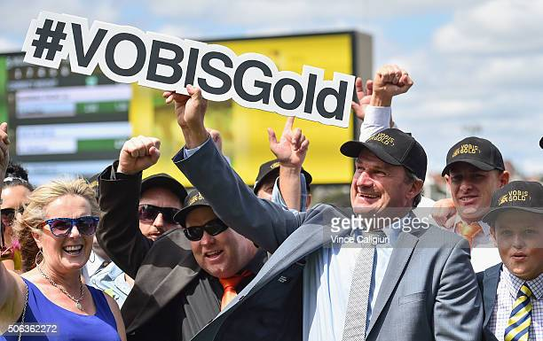 Trainer Darren Weir poses with vobisgold sign after Burning Front won Race 5 the IPRINTVOBIS Gold Star during Melbourne Racing at Moonee Valley...
