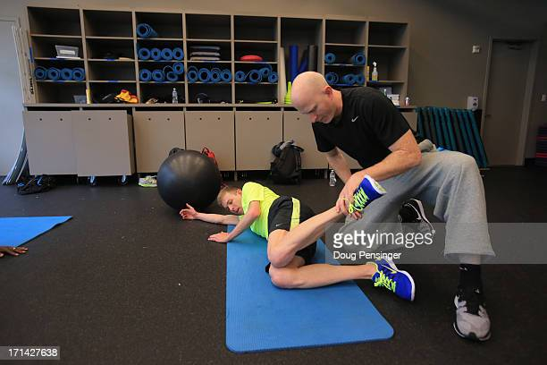 Trainer David McHenry works with Galen Rupp of the USA Track and Field Team in the Oregon Project on the Nike campus on April 13 2013 in Beaverton...