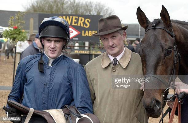 Trainer Des Hughes and jockey Kieran Kelly with Colonel Braxton after winning the Menolly Homes Champion Novice Hurdle at Fairyhouse