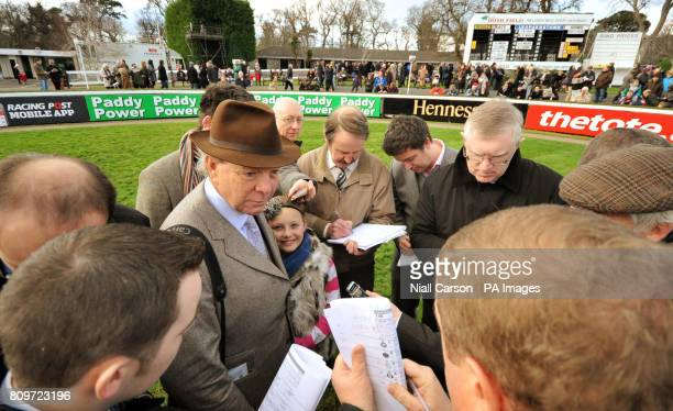 Trainer Edward O'Grady gives interviews after Cash and Go ridden by Andrew Lynch jumps won The paddypowercom Future Champions Novice Hurdle during...