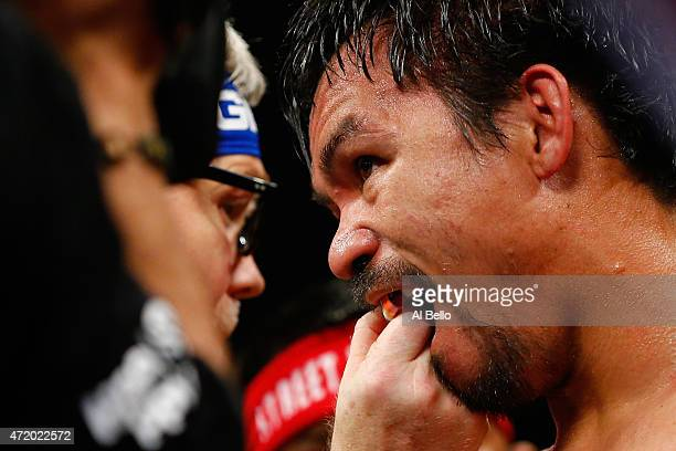 Trainer Freddie Roach adjust Manny Pacquiao's mouthguard during the welterweight unification championship bout on May 2 2015 at MGM Grand Garden...