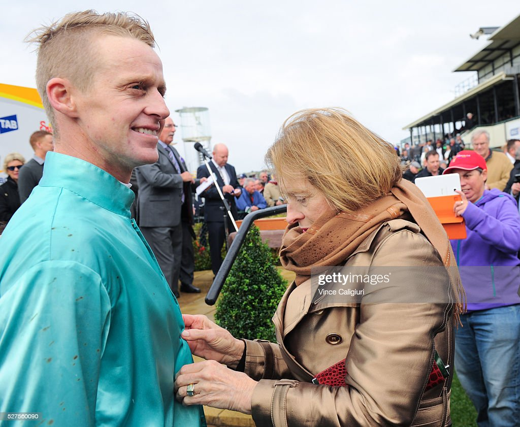Trainer Gai Waterhouse helps jockey Brad McLean with his silks before the presentation after Valediction won Race 6, the Brierly Steeplechase during Brierly Day at Warrnambool Race Club on May 3, 2016 in Warrnambool, Australia.