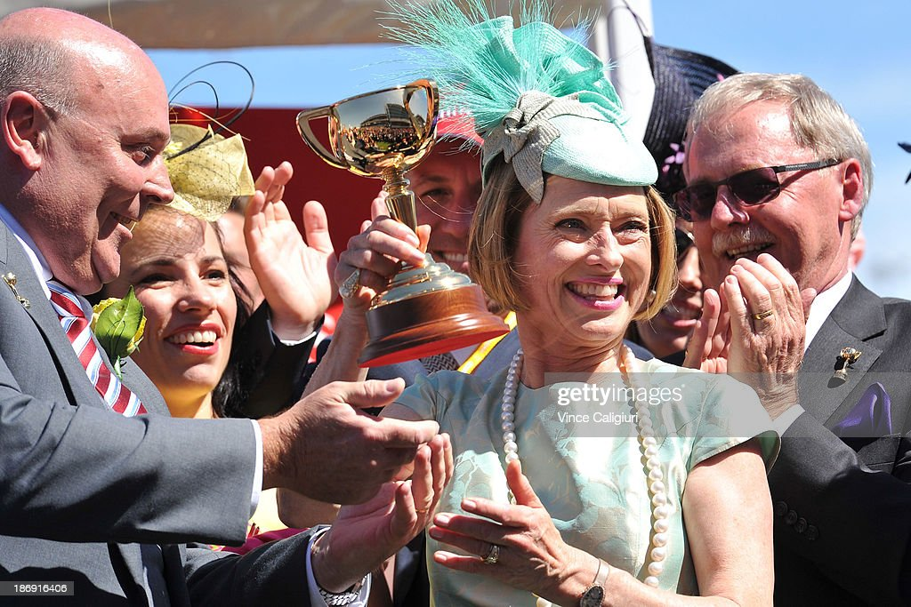 Trainer <a gi-track='captionPersonalityLinkClicked' href=/galleries/search?phrase=Gai+Waterhouse&family=editorial&specificpeople=239456 ng-click='$event.stopPropagation()'>Gai Waterhouse</a> is presented with the trophy after Fiorente won the Emirates Melbourne Cup during Melbourne Cup Day at Flemington Racecourse on November 5, 2013 in Melbourne, Australia.