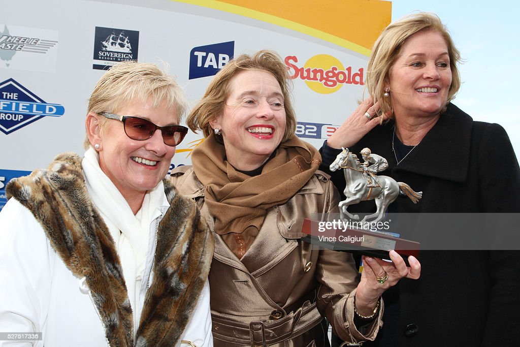 Trainer <a gi-track='captionPersonalityLinkClicked' href=/galleries/search?phrase=Gai+Waterhouse&family=editorial&specificpeople=239456 ng-click='$event.stopPropagation()'>Gai Waterhouse</a> poses with trophy and winning connections after Valediction won Race 6, the Brierly Steeplechase during Brierly Day at Warrnambool Race Club on May 3, 2016 in Warrnambool, Australia.