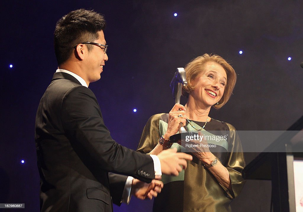Trainer <a gi-track='captionPersonalityLinkClicked' href=/galleries/search?phrase=Gai+Waterhouse&family=editorial&specificpeople=239456 ng-click='$event.stopPropagation()'>Gai Waterhouse</a> receives the Champion two year old award for racehorse Overreach during the Australian Racehorse of the Year Awards at Peninsula on October 3, 2013 in Melbourne, Australia.