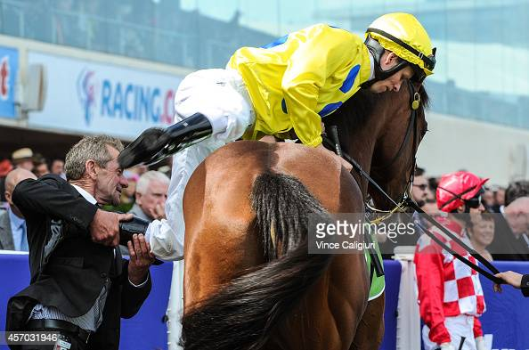 Trainer Gerald Ryan helps Kerrin McEvoy aboard Rubick before winning Race 4 the Anco Instant Turf Schillaci Stakes during Caulfield Guineas Day at...