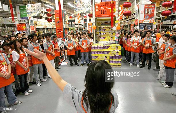 A trainer gives last minute instructions to the staff prior to the opening of US home improvement chain Home Depot's first outlet in Beijing 26...